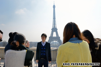 Chinese tourists at Eiffel Tower