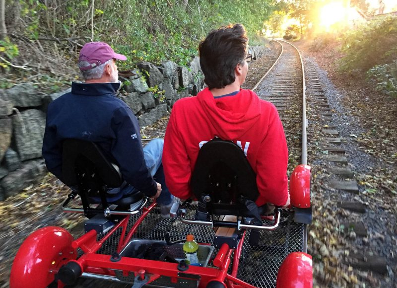 Two men rail biking in Rhode Island