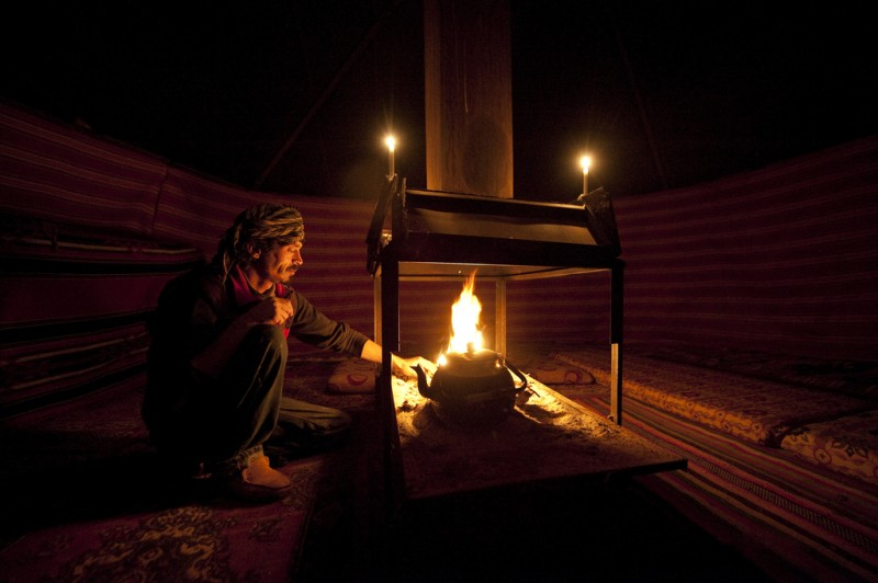 Man sitting alone by fire in Wadi Rum, Jordan